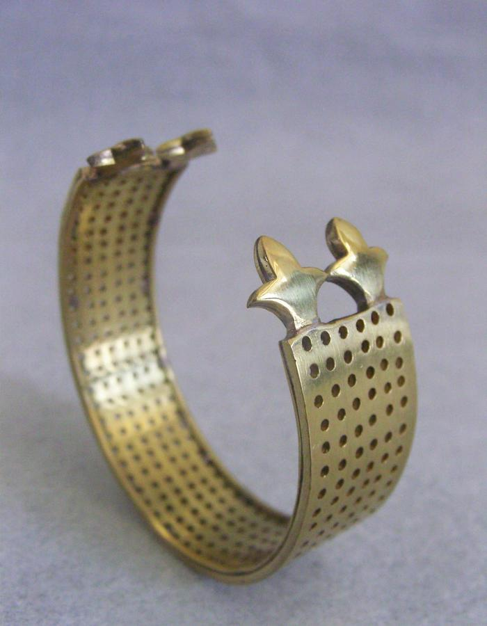 Free size hand cuff made without using any industrial technique of mass production.