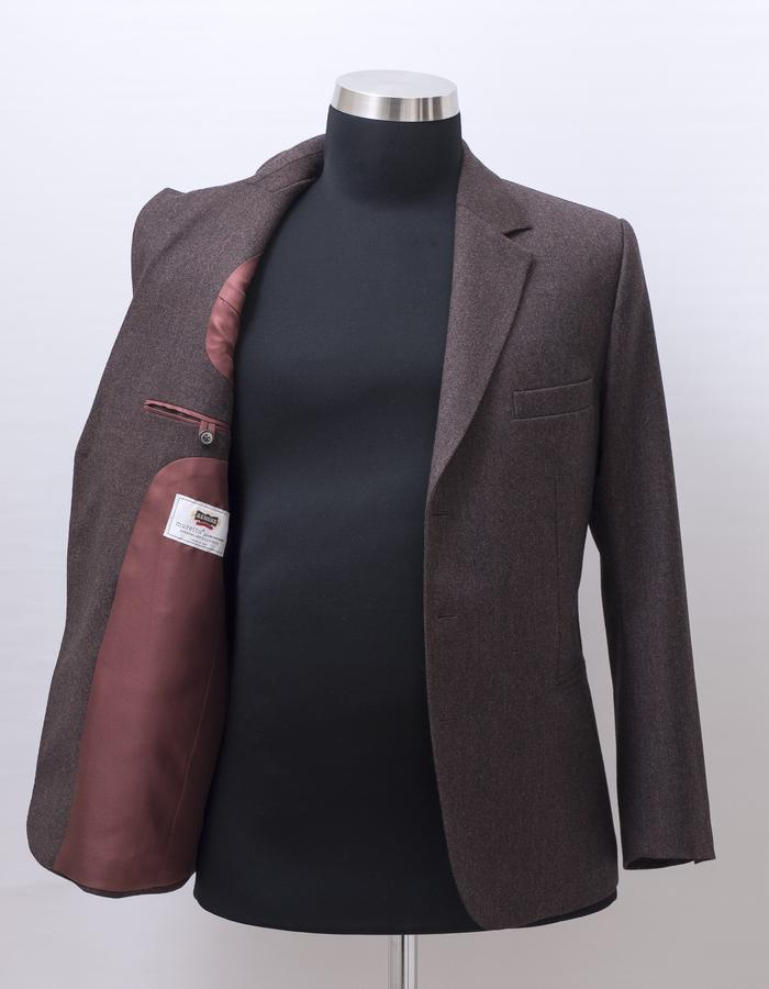 The suit jacket made of Agnona 140'cashmere-wool fabric with hybrid medium construction in English style