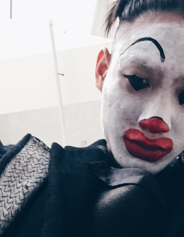 """In this photo series, I took self portraits of myself on my iPhone, parodying the """"instagram"""" fashion sensations. The face-paint makeup of Ronald McDonalds, is a commentary on how fashion designers and influencers are becoming a commodity, and a joke. Questioning the purpose of social media in the current fashion climate."""