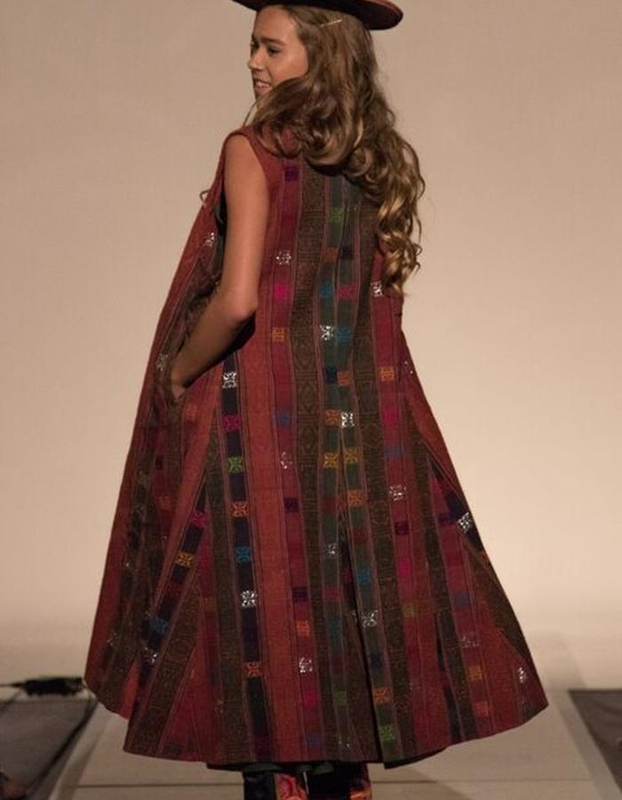 Coat heavily ornate with silk motifs in raw silk background.