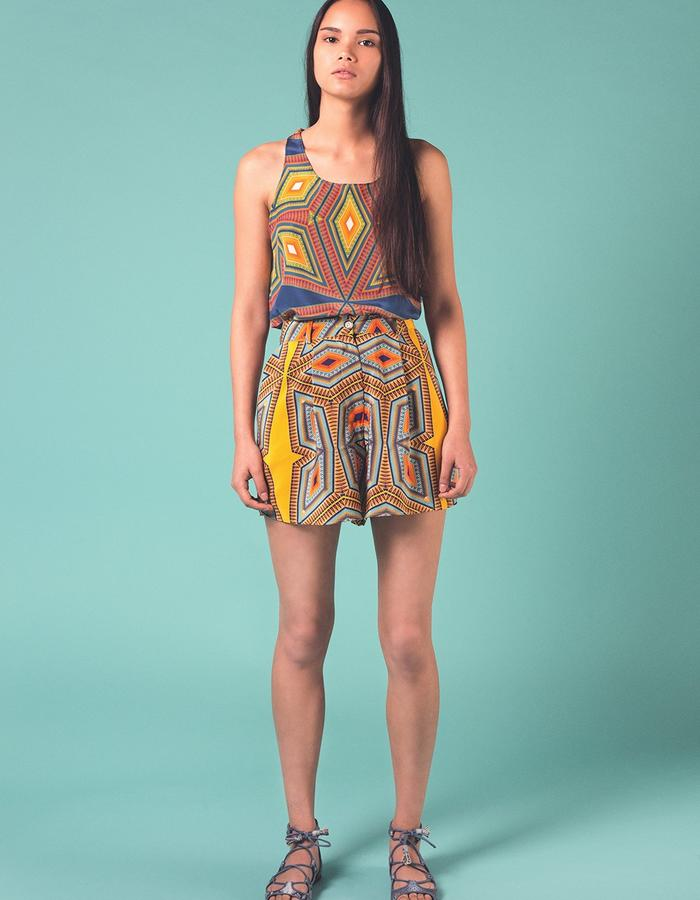 Blue Lagos vest worn with yellow Lagos shorts. Both are 100% Silk crepe de chine. Printed and manufactured in the UK