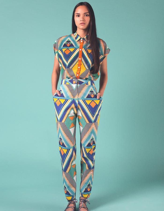 Orange Dala Dala silk sleeveless shirt worn with matching 100% Egyptian cotton trousers. Printed and manufactured in the UK