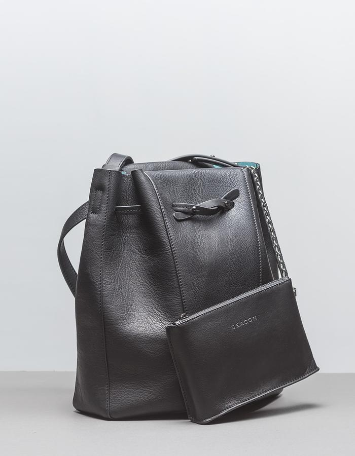 DEACON the Seine in black. with pouch