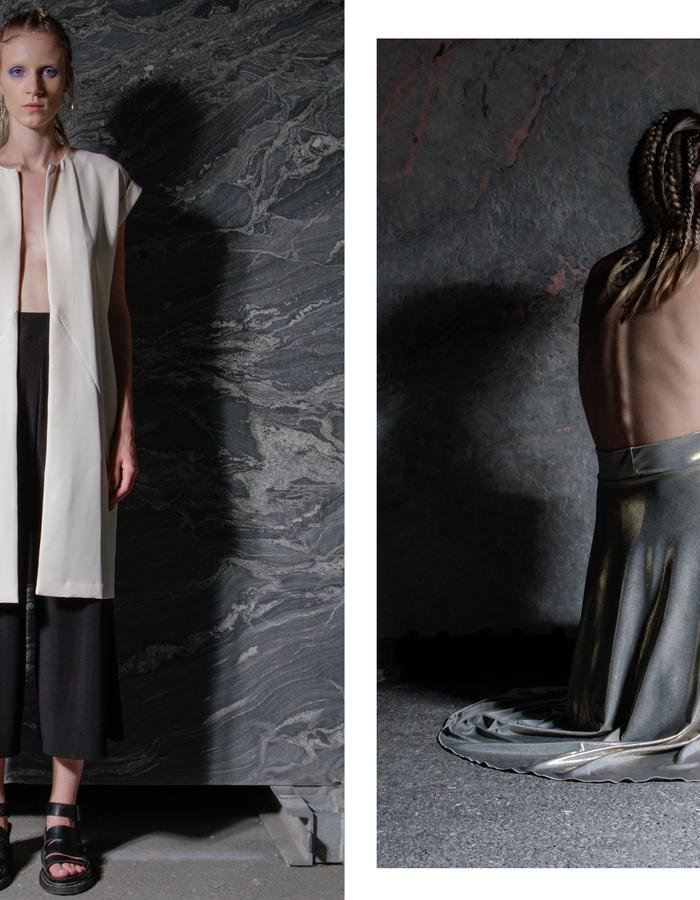 Ecru oversized, long vest and black jersey cullottes. Shiny gold/silver round skirt.
