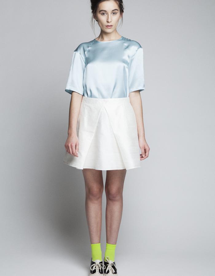 Zoe Carol Womenswear silk teal blouse and silk white pleat skirt