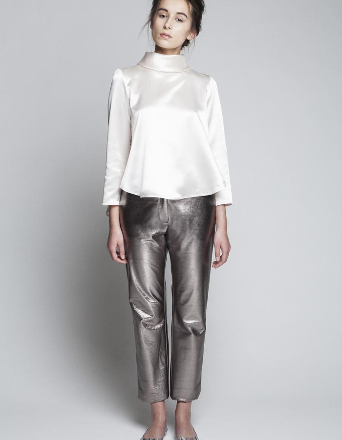 Zoe Carol Womenswear silk roll neck blouse and foil leather trouser pants