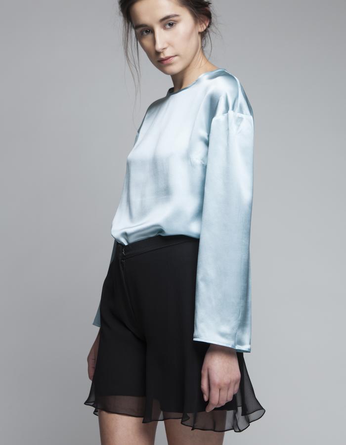 Zoe Carol Womenswear silk teal blouse and silk wool black shorts