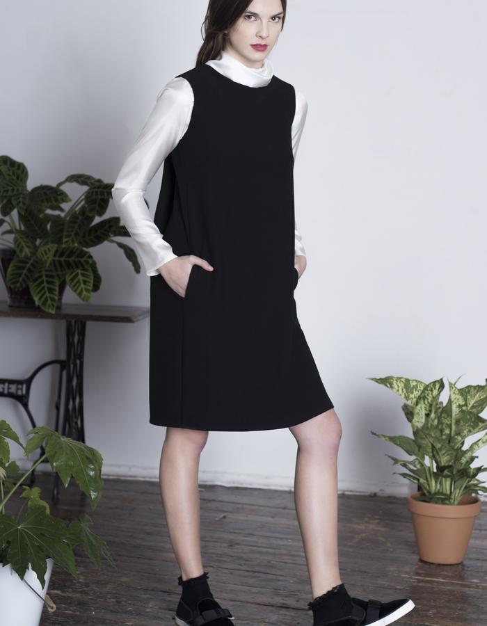 Zoe Carol Womenswear black crepe Drape cape dress and white silk roll neck long sleeve blouse