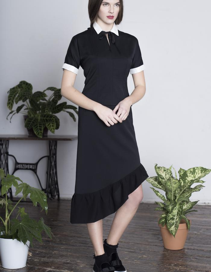 Zoe Carol Womenswear black wool asymmetric ruffle hem skirt and fitted black and white silk and wool collared top