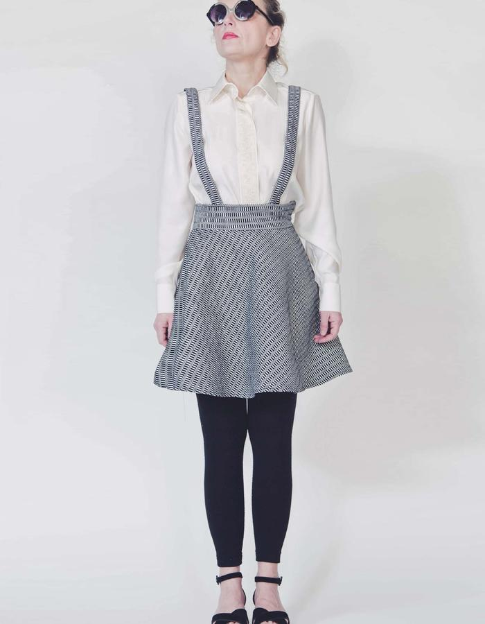 Silk satin shirt, hand woven cotton wheel skirt with suspenders.
