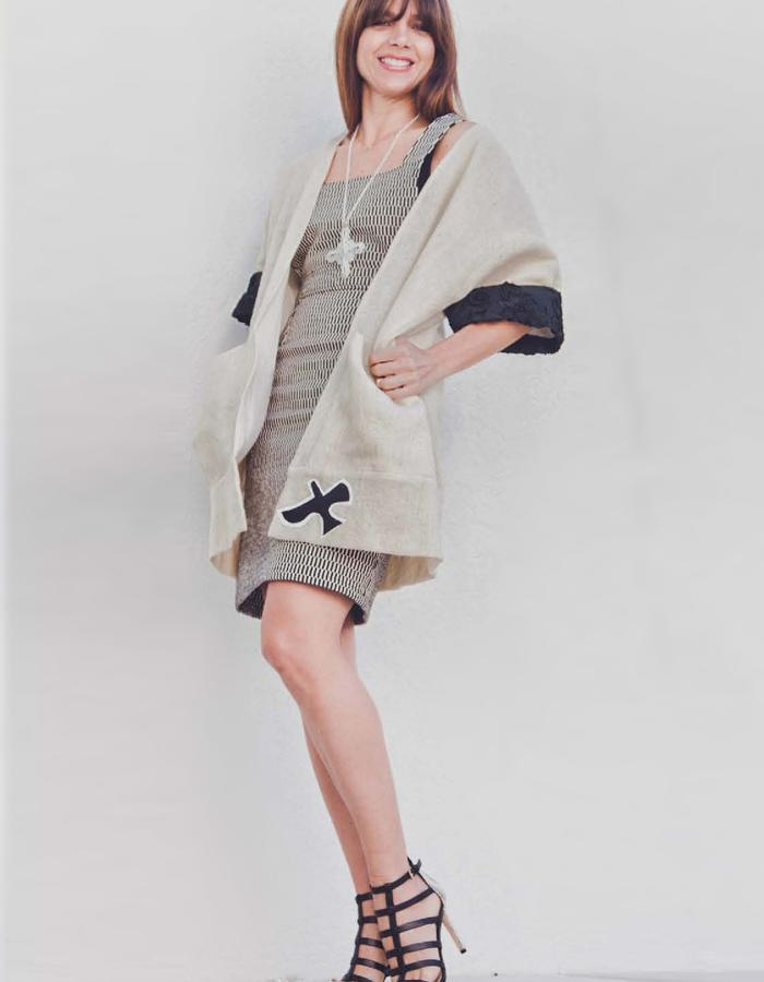 Ecological wool kimono with applications.