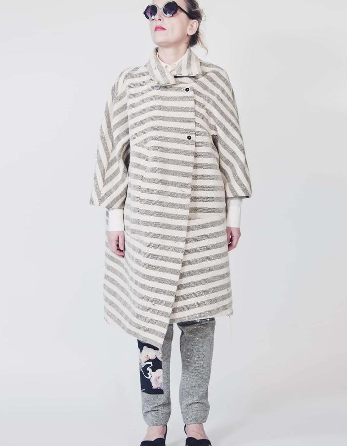 Ecological striped wool asymmetrical overcoat.