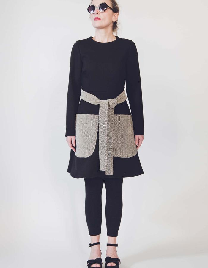 Crepe wool dress with hand woven cotton pockets and belt.