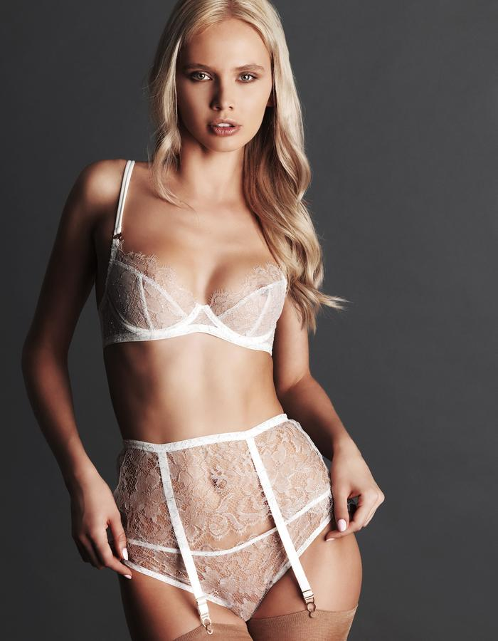 BRIGITTE An alluring collection designed to enhance every curve with its flirty manner. These timeless designs are enhanced with the use of a floral French Chantilly lace embroidered with metallic threads and edged in a sultry scallop. Brigitte masters the art of the tease effortlessly.