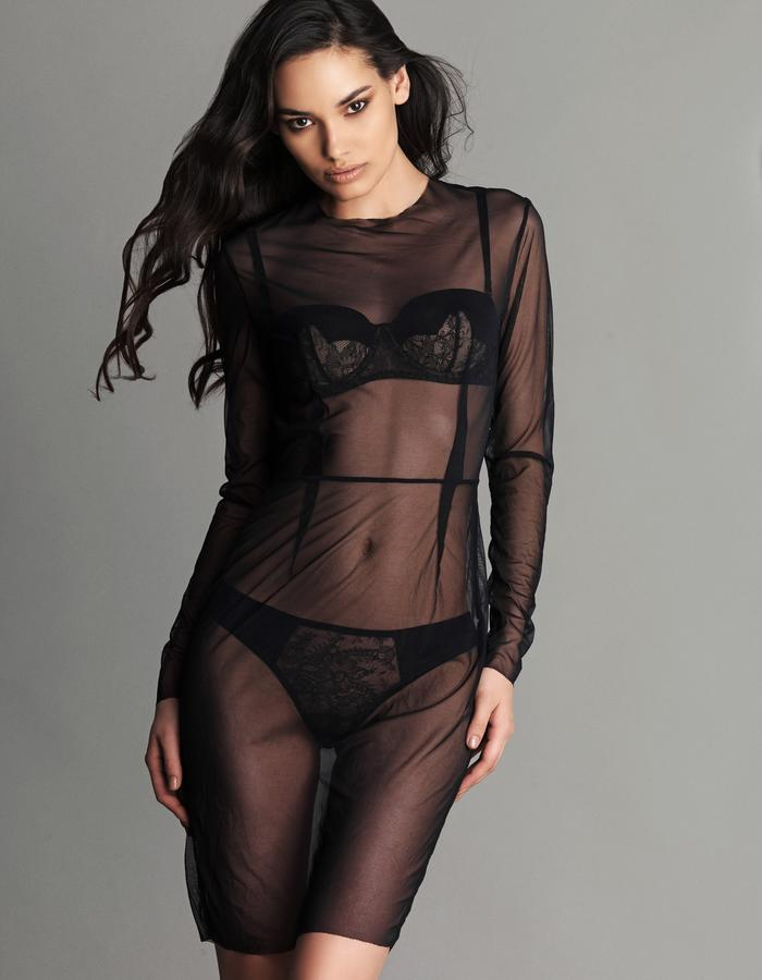 A stunning super sheer dress that nips in the waist and uses cleverly placed darts to draw the eye down the body. The dress features a concealed zip at the side seam allowing for easy dressing and undressing. Wear with your favourite Fréolic lingerie pieces underneath or wear with nothing at all, you decide...