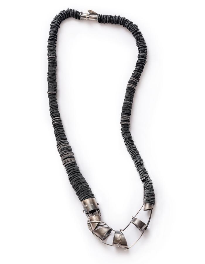 Necklace / materials: oxidized sterling silver, leather