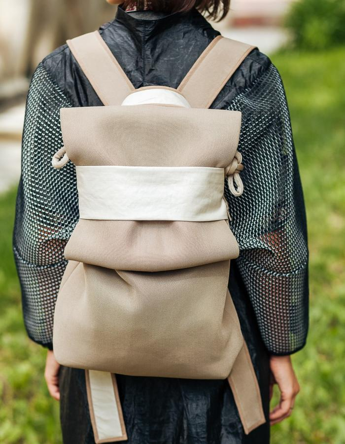 Air mash backpack. Size: 38*27*13; 4 pockets; waterproof double lining. Very lightweight and functional.