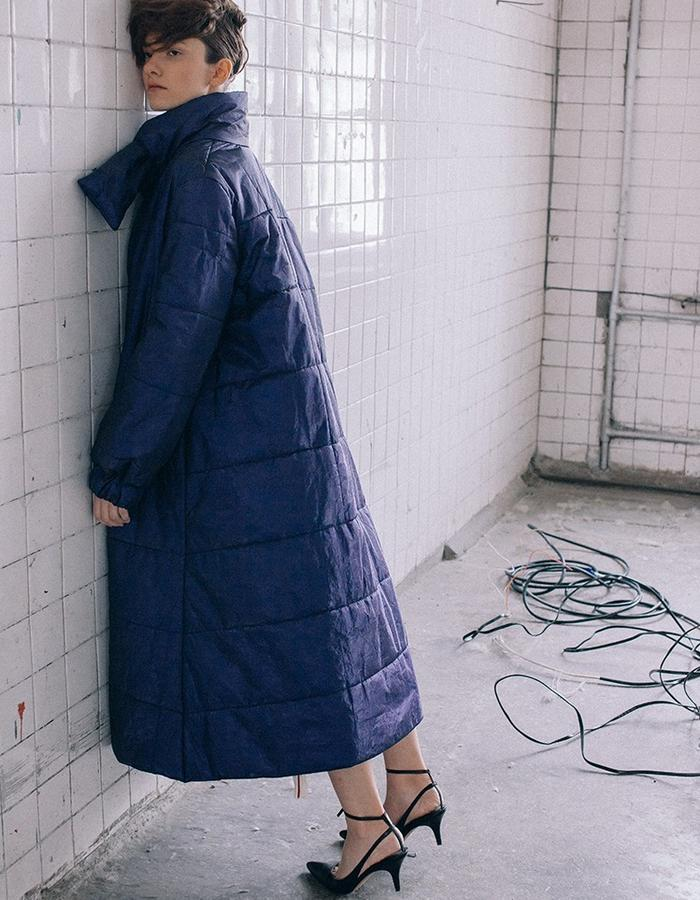 Trapeze warm padded coat  made of innovative water resistant material with hand stitch and elongated collar