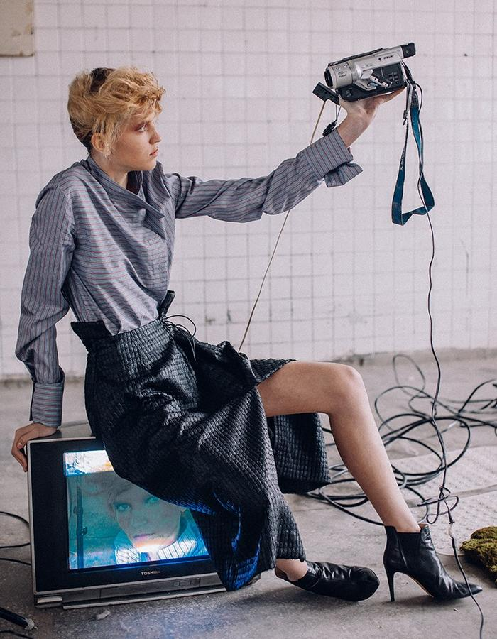 Futuristic complex cut skirt  with the element bow made from innovative breathable material