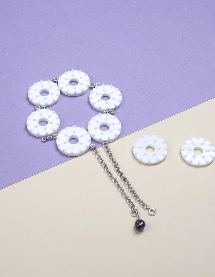Kuznetsov massage mattress' necklace and brooches
