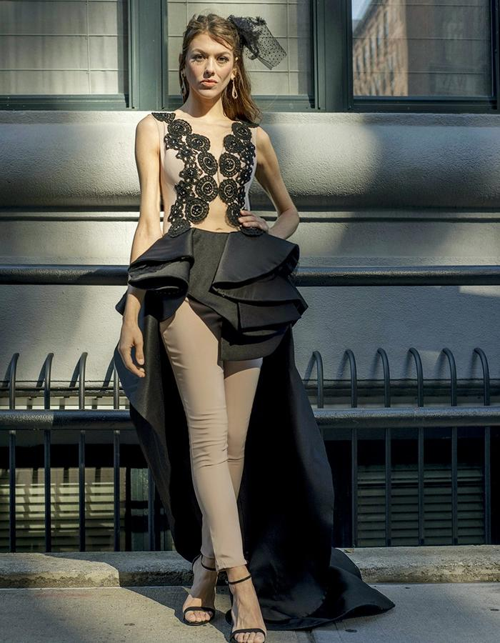 Nude jumpsuit with a black ruffled train and guipure beaded appliques on the corsage.