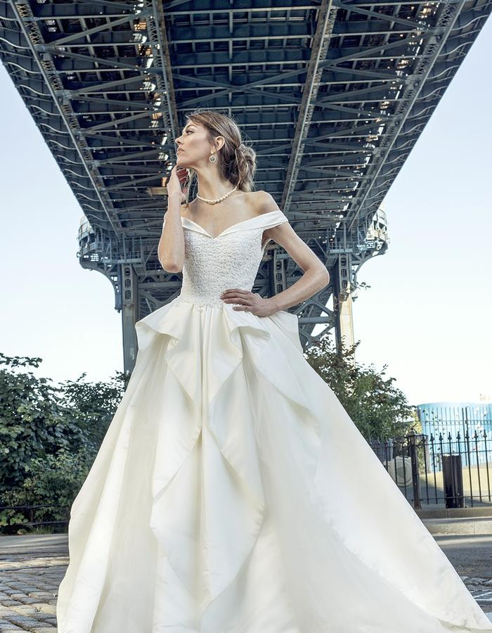 Vintage bridal dress with a fully beaded corsage and satin ruffles covering tulle ballgown skirt