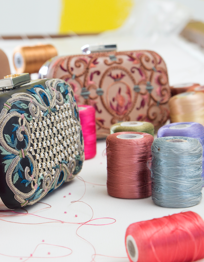 Various embroidered clutches