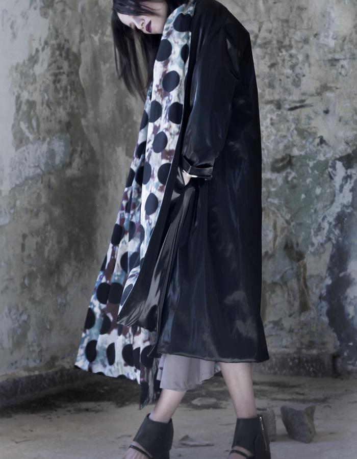 shiny black coat with polka dot cotton lining