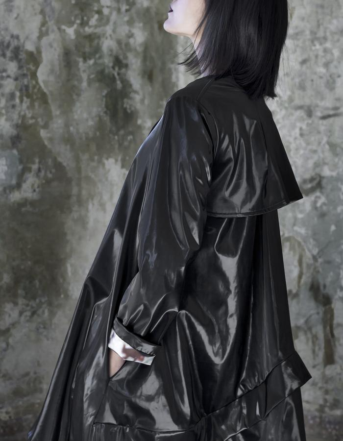 shiny black raincoat with polka dot cotton lining