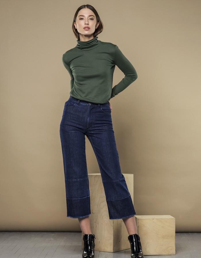 PINE GREEN TURTLENECK AND DENIM BLUE CROPPED JEANS