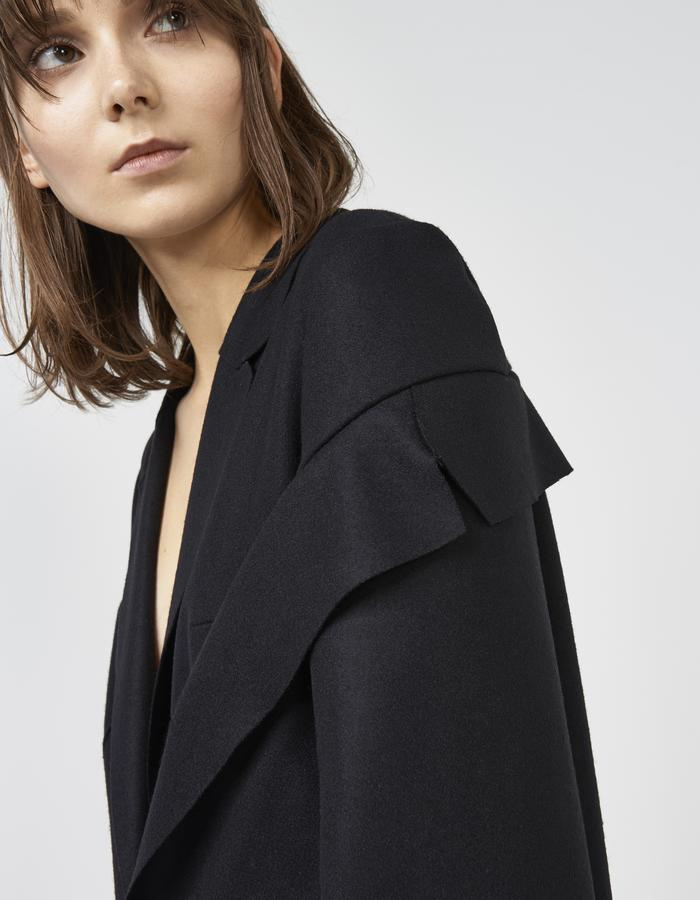 Black deconstructed off shoulder coat by Boyarovskaya made in Paris of wool and cashmere