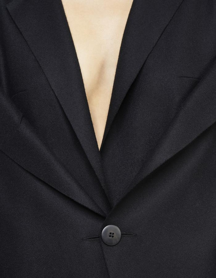 Black deconstructed off shoulder coat by Boyarovskaya made in Paris of wool and cashmere detail