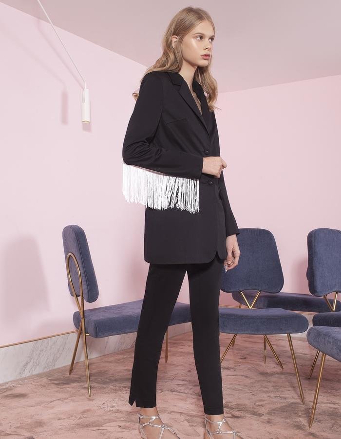 black jacket with fringes and pants