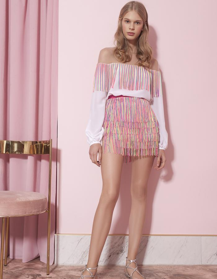 white top with fringes and pink mini-skirt with fringes