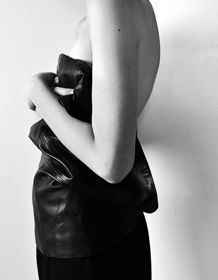 WALDMANN Image of leather top around torso. Photographed in London. Styled by Elle Waldmann