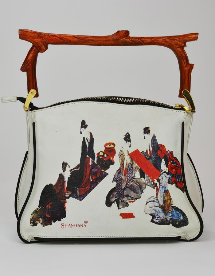 The Geisha Bag. The two different geisha paintings on either side are derived from the Ukiyo-e tradition of ancient Japanese wood block printing