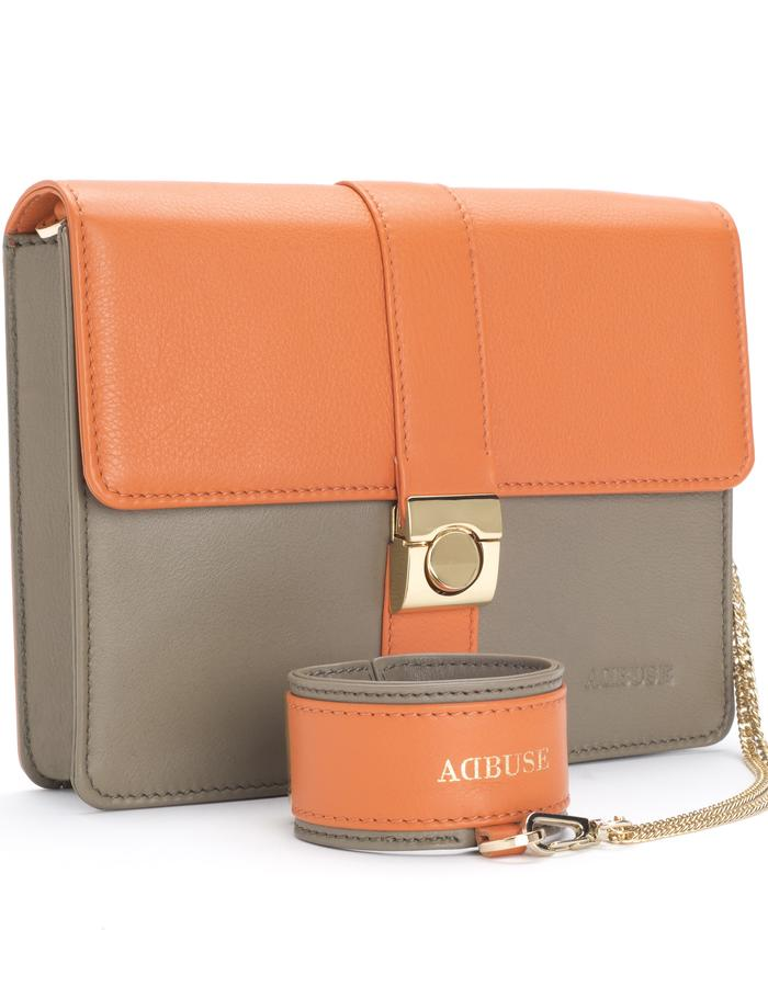 "AdBUSE SUNRISE ""bracelet clutch"" handmade of smooth orange and taupe nappa calf leather."