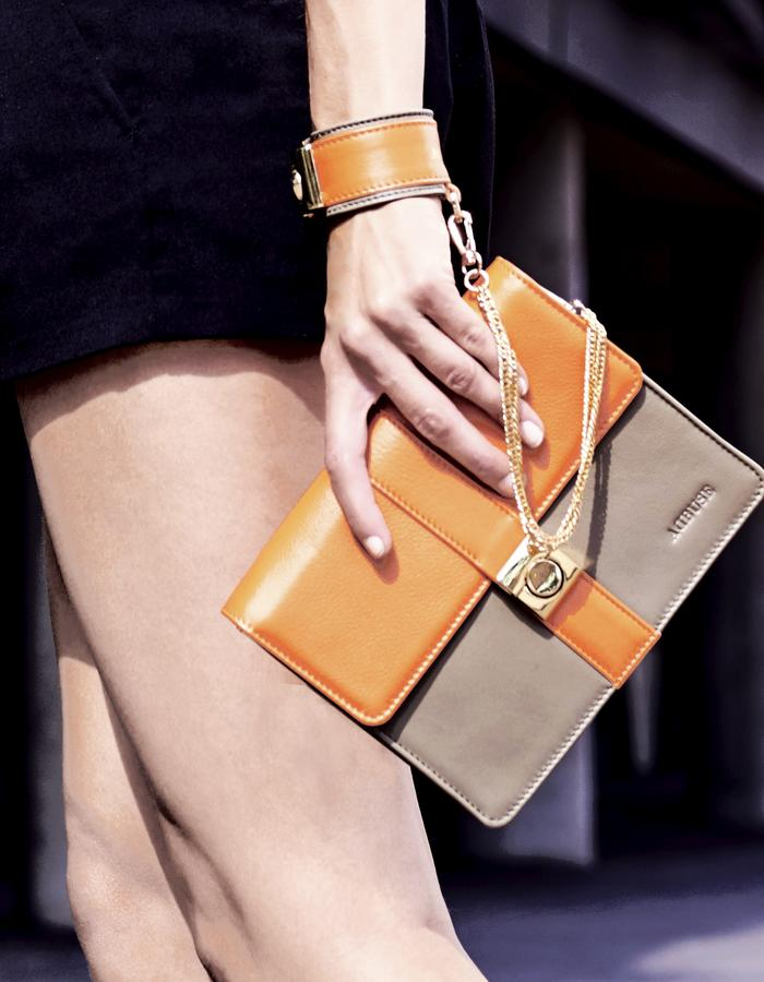"""Detail of AdBUSE SUNRISE """"bracelet clutch"""" handmade of smooth orange and taupe nappa calf leather."""