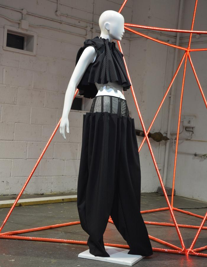 pleated trousers with corset and pleated cropped top