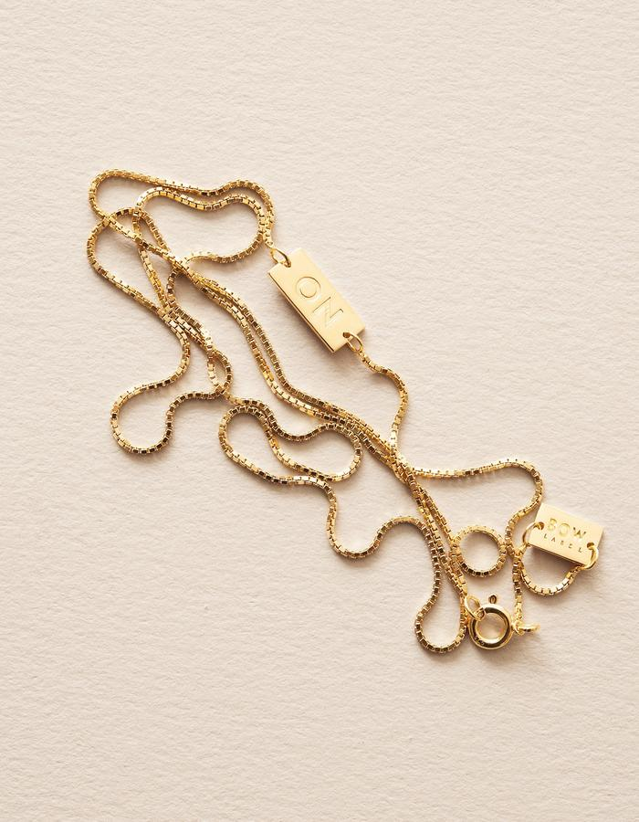 BOW LABEL_JOY IS GREATER THAN SORROW_ NECKLACE_GOLD PLATED_SILVER
