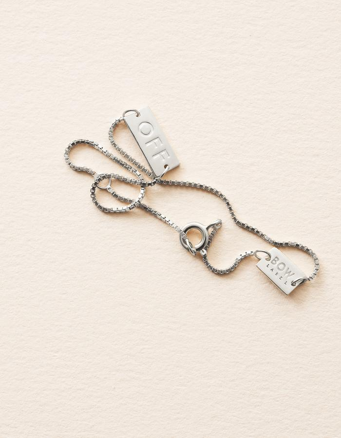 BOW LABEL_JOY IS GREATER THAN SORROW_ BRACELET_RHODIUM PLATED_SILVER