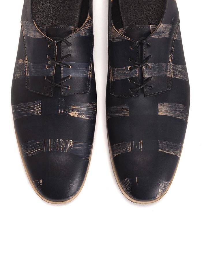Man shoes black streaks.