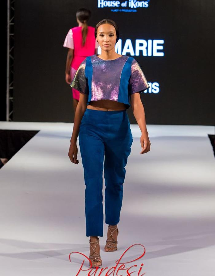 Cobra printed leather detail and blue suede leather crop top. Suede trousers.