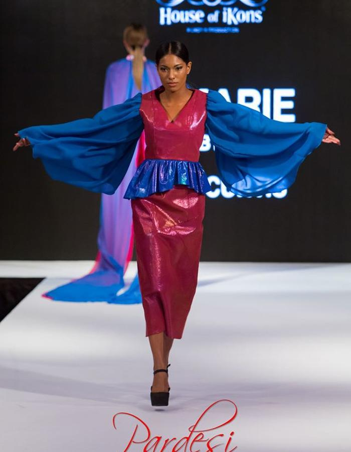 Burgundy two piece. Fitted bodice with gathered detail and chiffon sleeves. Panelled skirt
