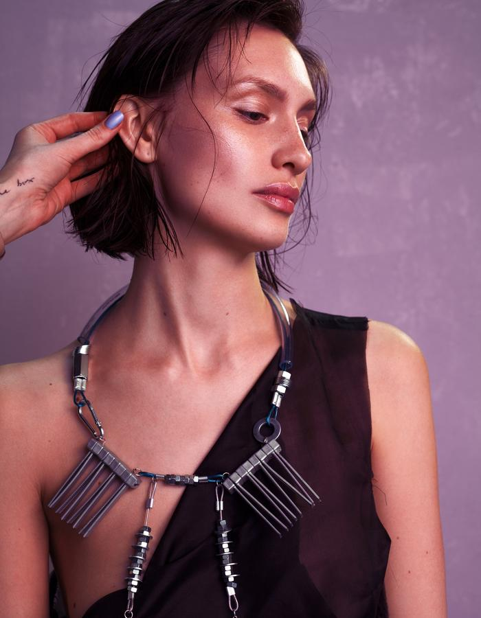 contemporary jewelry necklace with swarovski pearls and metal details