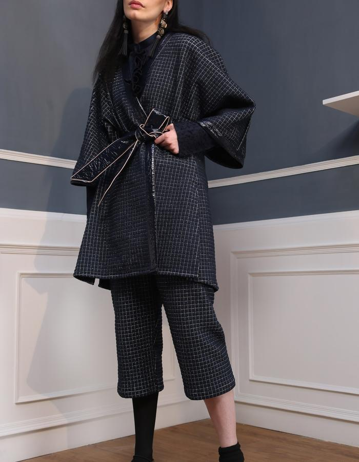 Quilted kimono wrap jacket with cigarette pants.