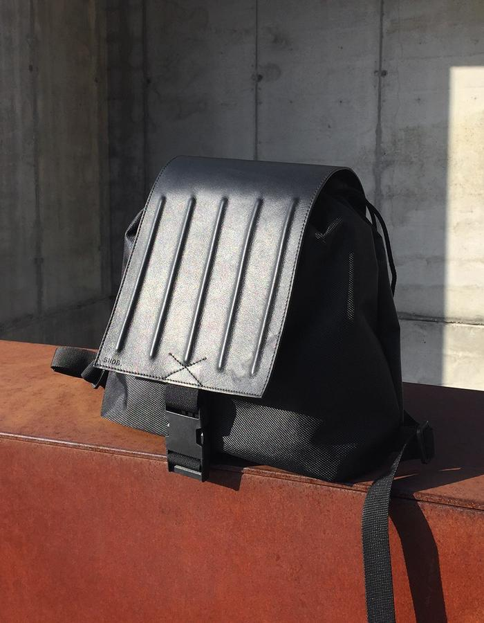 snob. 2017 All Black Collection - leather and nylon - embossed stripes flap backpack