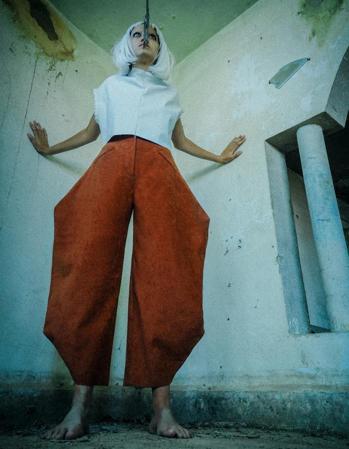 Iconic brutal brick-red tailored pants.