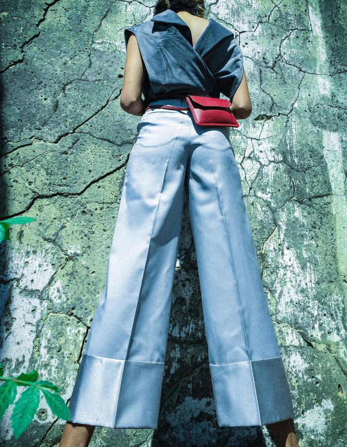 Tailored straight pants with red belt bag