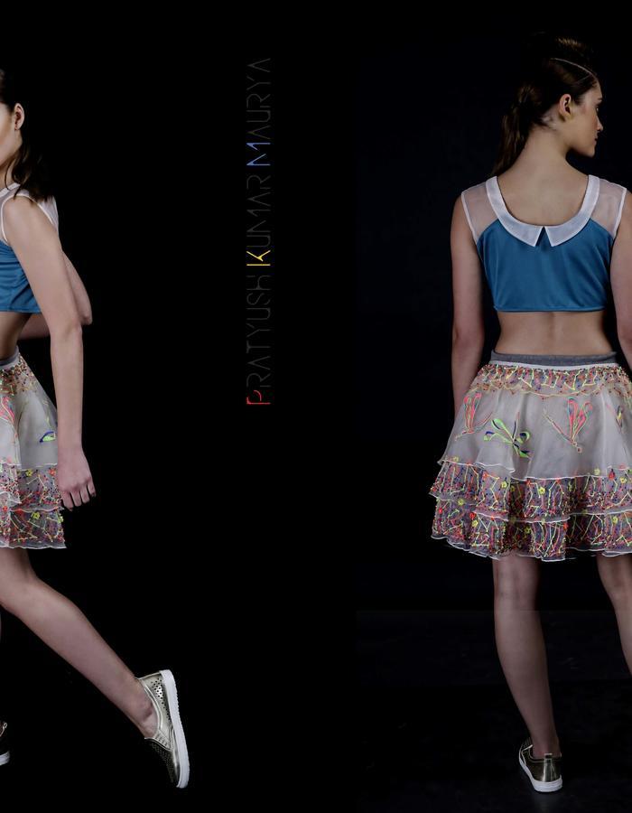 Hand embroidered Silk organza skirt cum shrug with sleeveless blouse.
